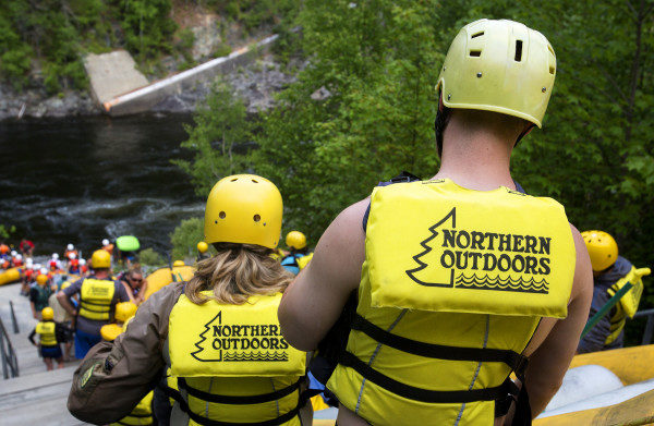 THE FORKS, MAINE -- 07/28//2016 - Northern Outdoors rafters wait to put their boats in the Kennebec River for a rafting trip Thursday in The Forks. Suzie Hockmeyer and her former husband, Wayne Hockmeyer, are widely regarded as the founders of whitewater rafting in Maine. Now in her mid-60s, Suzie is still a registered whitewater guide, taking groups on adventures from Northern Outdoors in The Forks.  Ashley L. Conti | BDN